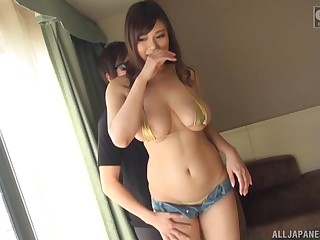 Sasamiya Erena gets her pussy pleased by friend's sex toys on a difficulty couch