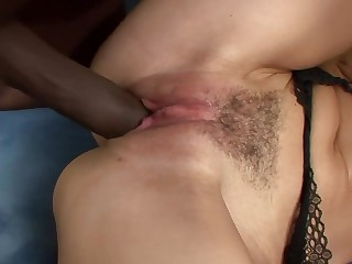 A milf in the matter of a spot on target on touching ass is getting a black dick inside her