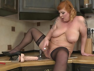 Chubby mature amateur Alex stuffs her pussy with toys in the Nautical galley