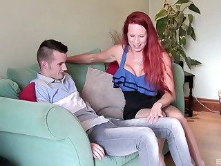 Grown up redhead bombshell Julie Faye rides a younger dude in stockings