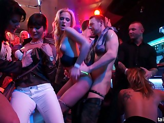 Wild orgy takes place befitting in the night club with voracious bitches