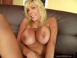 MILF blonde with big tits having her shaved twat screwed hardcore